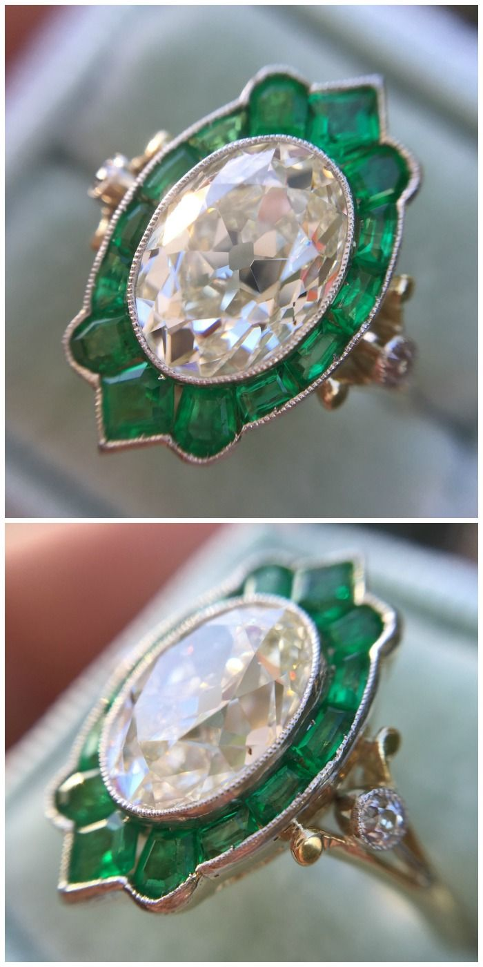 Incredible antique 2.12 carat oval diamond ring with amazing emerald halo.