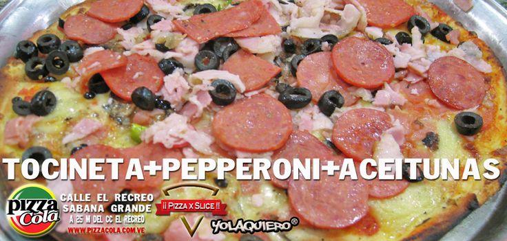 Pizza con Tocineta, pepperoni y aceitunas estilo pizzacola. Full queso y bien resuelta.La pizza como tiene que ser.  Website www.pizzacola.com.ve