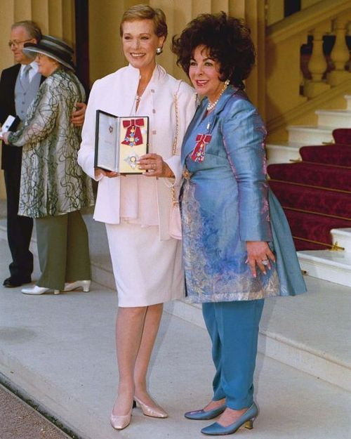 2004 Julie Andrews revicing the Dame of British Empire Medal Honor from Buckingham Palace. London Here with Elizabeth Taylor.