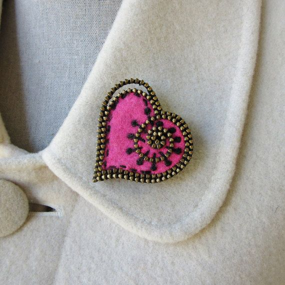 A lovely hot pink felt heart brooch embellished with pieces of brass zipper and hand embroidery. I enveloped the heart with two layers of the