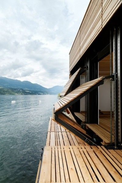 nonconcept:  Folding wooden shutters on a luxury house next to a lake.