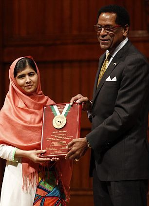 Malala Yousafzai, Pakistani girl 15, who was shot in the head by Taliban for demanding women's education receives standing ovation at Harvard, is presented with the 2013 Peter J. Gomes Humanitarian Award by Director of the Harvard Foundation and Professor of ...