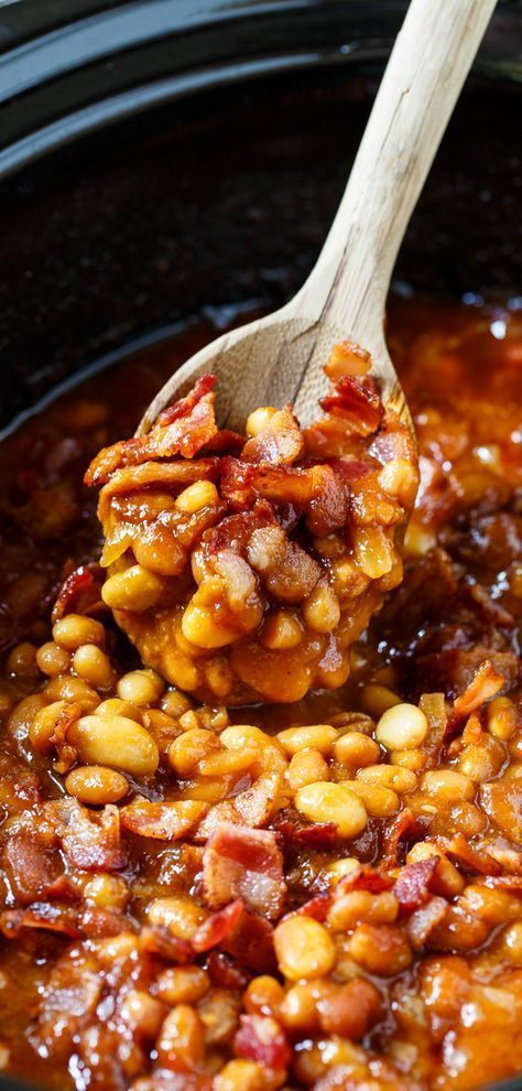 Slow Cooker Bourbon Baked Beans. No need to heat up your kitchen making baked beans for your summer cookouts. Slow cook them in the crock pot!