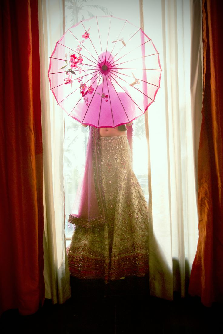 ...umbrella coming out of her face.  What happens when East Asia and South Asia come together in Holy Matrimony  #fusion