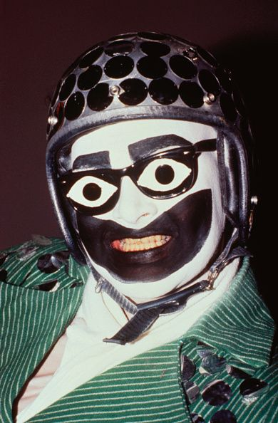 Portrait of performance artist Leigh Bowery heavily made up wearing a helmet Taboo 1986