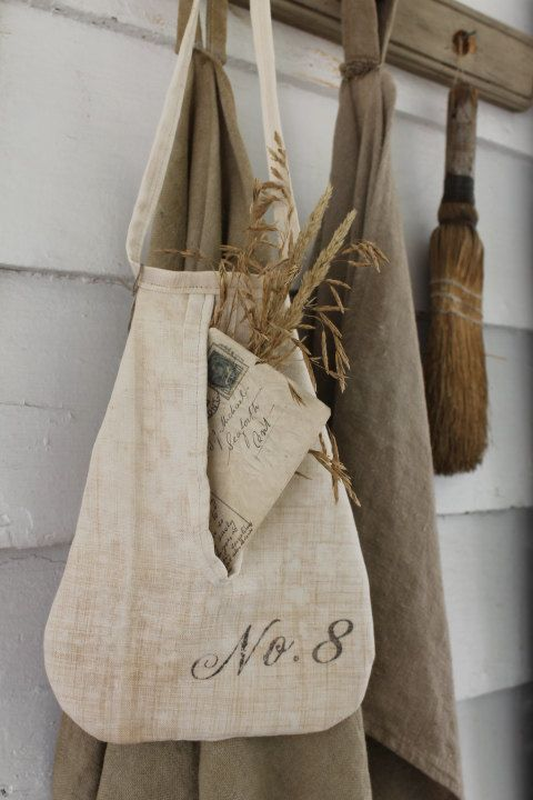 I LOVE to make these pockets! I found this fabulous antique linen sheet at an antique market and knew instantly what I would do with it...it was
