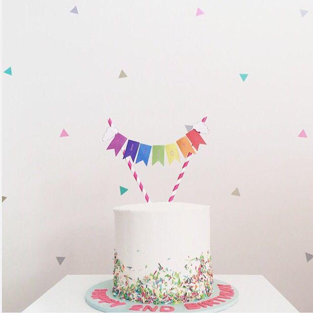 Rainbow Cake! Vanilla layer cake with vanilla buttercream, and rainbow bunting banner