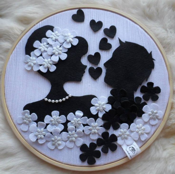 Wedding silhouette. This would be a great way to use some of the ribbon and flowers from our wedding cake! I could embroider the date on there too