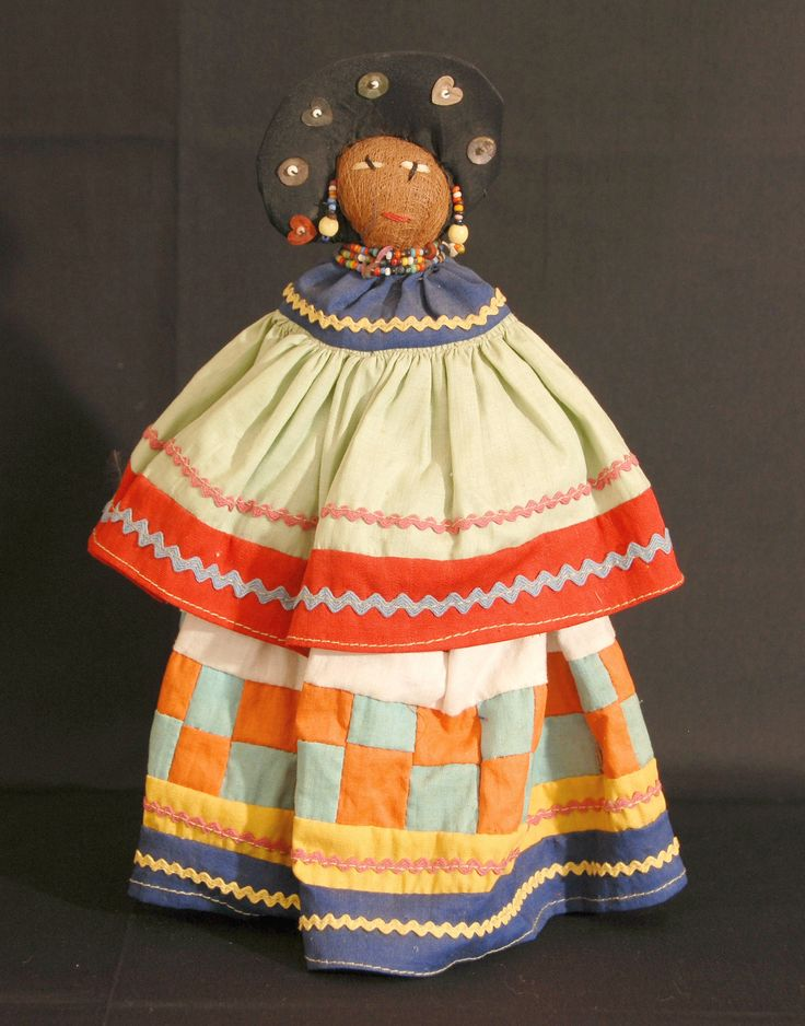 This old Seminole palmetto doll wears a pretty patchwork skirt.