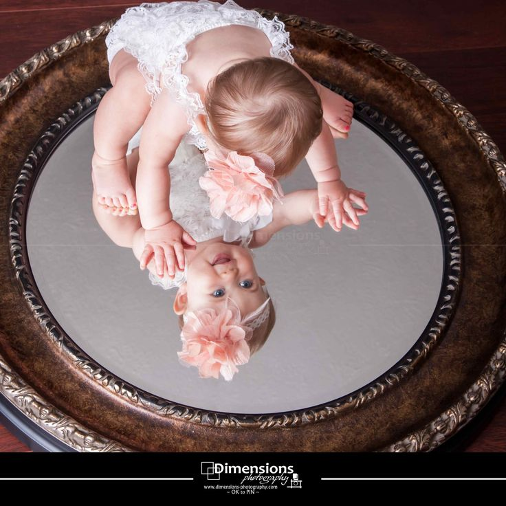 be still my heart... one year old little girl on a mirror www.dimensions-photography.com