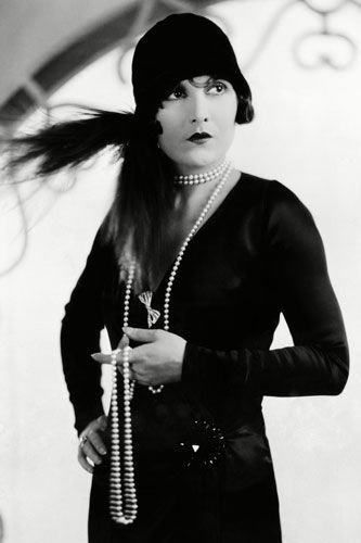 EVELYN BRENT  This smouldering silent film star widely known for her part as the original moll in Hollywood's first gangster movie Underworld. Think cool cloche hat, liberal feather detailing and an aura of detachment.