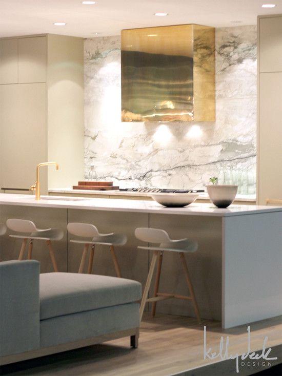 Contemporary Kitchen: brass hood, full height marble slab backsplash, grey cabinets
