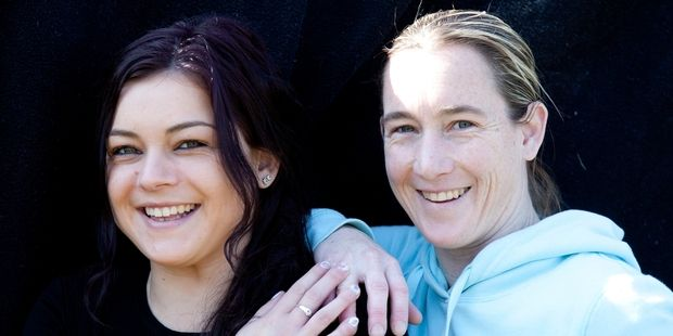SPREADING THE LOVE: Kristie Purton, 31, and Nikki Reynolds-Wilson, 24, have spent the past 65 days doing good deeds for others in the Tauranga community. PHOTO/ANDREW WARNER