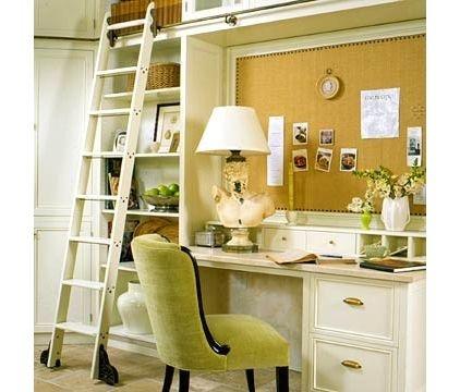 cork board above desk + rolling ladder