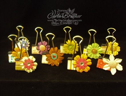 altered binder clips #crafts  cut a piece of paper 1-1/4 x 2 and attach it to the binder clip using Sticky Strip.  Attach the flowers or other embellishment with a glue dot