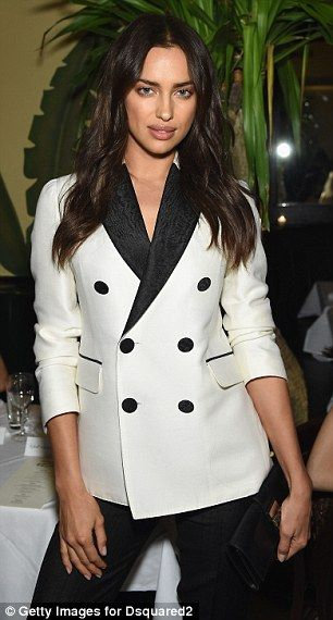 Bold choices: Irina caught the eye in a double breasted monochrome blazer......