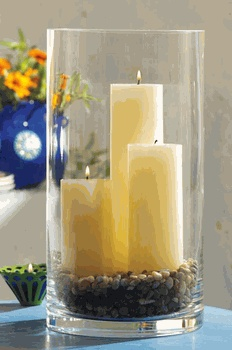 Tall Cylinder Clear Glass Vase --- is this similar to what the hall has?  One candle with crystals at the bottom?  Pretty.