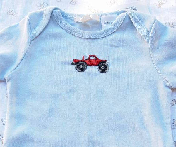 $14.95      Pickup Truck   Size 1   Pale blue onesie, hand sewn with a big red 4WD Pick Up Truck or Ute – just like Dad's?  Zoom around in this versatile outfit – team it with jeans or shorts for going out,  or leave it as it is on those hot days at home.  100% Cotton  (looks to be a large fit, Australian sizes run roughly to age, size 1 for 1 yr old, size 2 for 2yo etc.)