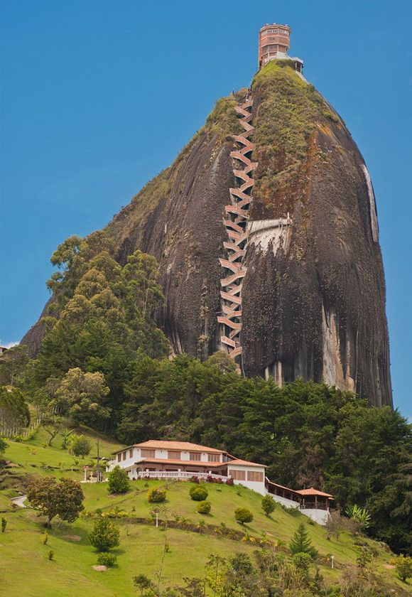 El Peñón de Guatapé is a monolithic formation located at the town and municipality of Guatapé, 1 km (0.6 mi) inside the city limits in Antioquia department, Colombia. - http://www.theworldgeography.com/2012/12/plugs-and-monoliths.html