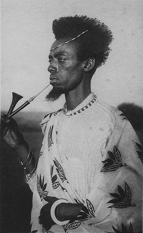 Africa | Mututsi man smoking. Rwanda || Scanned old postcard