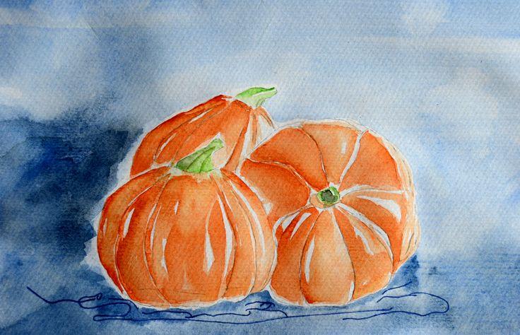 Three cute Halloween pumpkins by Liudmila Mehedinteanu.