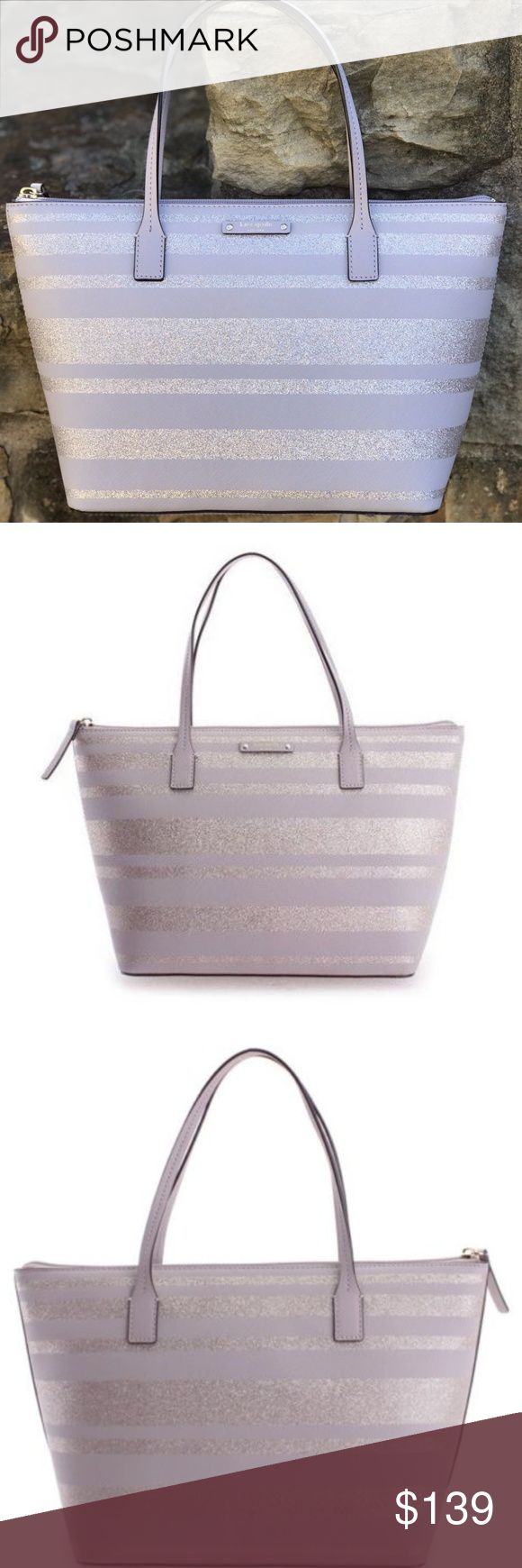 """NWT Kate Spade Hani Haven Lane Neutral Tote Brand New! Authentic Kate Spade New York Hani Haven Lane Tote.  Beautiful Nouveau Neutral Color.  Amazing Safiano Leather and Glitter matierial classic for Kate Spade.  Height 9.5"""" x Width 11"""" (bottom) 14.5"""" (top) x Depth 5""""  STRAP DROP: 6""""  HARDWARE: 14k Gold Plated  CLOSURE: Full Zipper  INSIDE: 2 Slots & 1 Zipper  This bag debuted September 2017.  Grab this Hani Haven Lane Neutral Tote while they last. kate spade Bags Totes"""