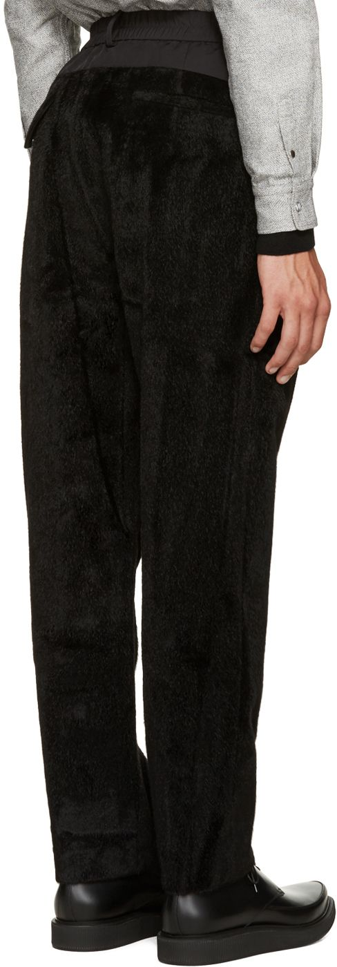 Relaxed-fit faux-fur lounge pants in black. Woven paneling at waist. Drawstring at elasticized waistband. Four-pocket styling. Tonal stitching.