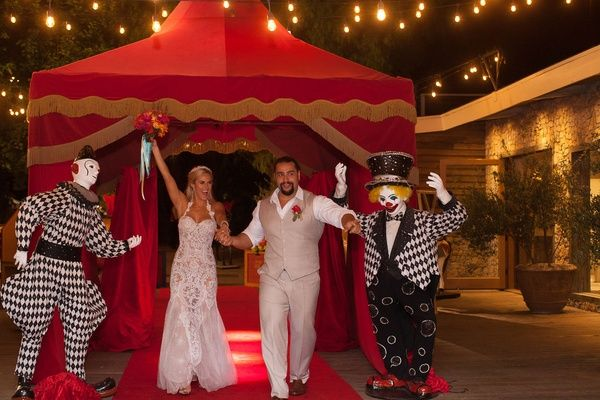 Lana %26 Rusev Running Through Circus Tent    Photography: Lucy Munoz Photography   Read More:  http://www.insideweddings.com/weddings/cj-perry-and-miroslav-barnyashev/961/