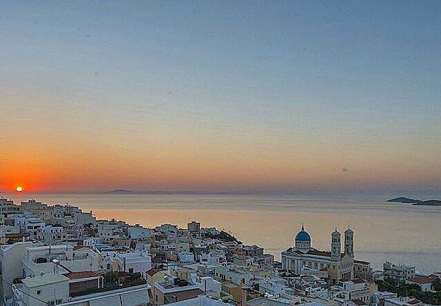 Magical sunset time at Syros island (Σύρος). Unique and so picturesque island .