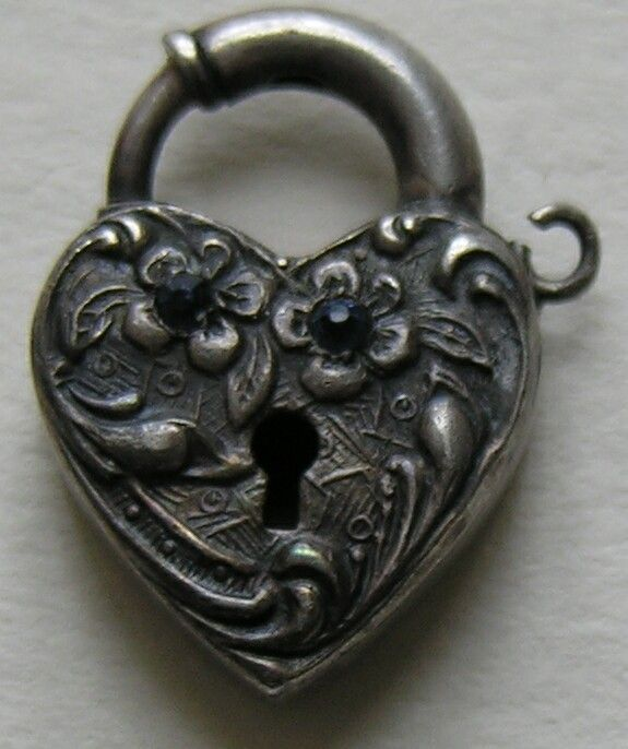This fun vintage (circa 1940) heart lock is one that can be a bit