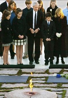 Caroline Kennedy is joined by daughters Rose and Tatiana, husband Edwin Schlossberg and son John, at her parents' gravesites at Arlington National Cemetery on the 40th Anniversary of JFK's assassination.