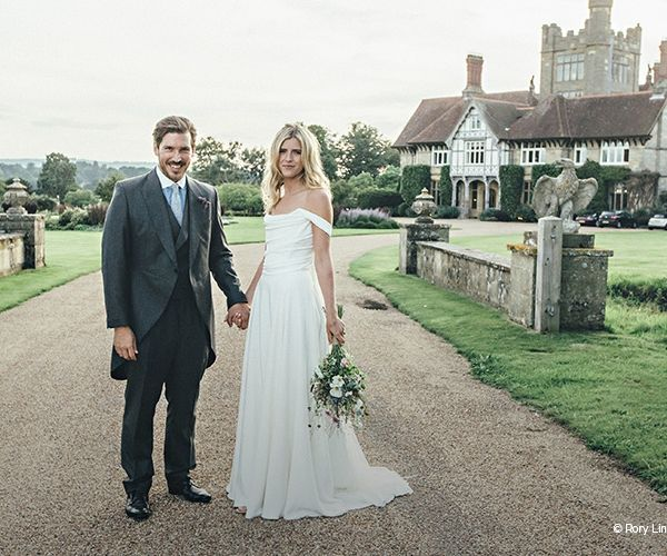 A couple taking a moment in the beautiful grounds at Cowdray House wedding venue in West Sussex   CHWV