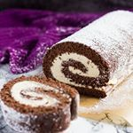 Who wants a generous slice of my Chocolate Swiss Roll Dont miss this recipe on the blogGrab the recipe link in my profile or here  httpmarshasbakingaddictioncomchocolateswissroll