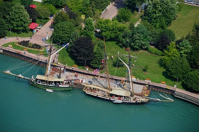 Beautiful shoreline of the Detroit River along the historic King's Navy Yard Park.  Two old friends are visiting, the tall ship Lynx and Friends Good Will.  Ahoy!