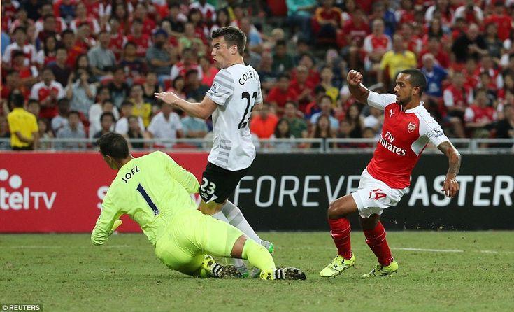 England international Walcott pokes the ball goalwards as Seamus Coleman and Joel Robles l...