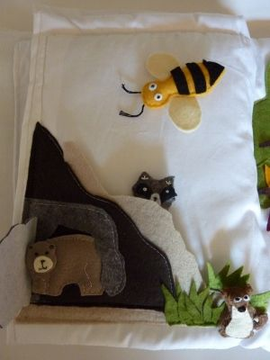 Mountain page with bear hiding in a cave, a raccoon, squirrel, and bee