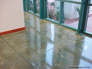 To get this polished concrete looking floor add color to the concrete sealer prior to applying the concrete sealer.