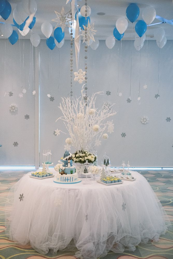 We love this fantastic candy table with the Frozen themed Birthday cake and desserts!!