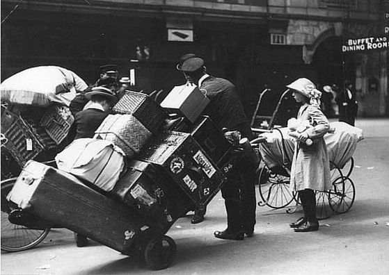 vintage photos of tourists traveling in style july porters helping with their luggage at waterloo station london