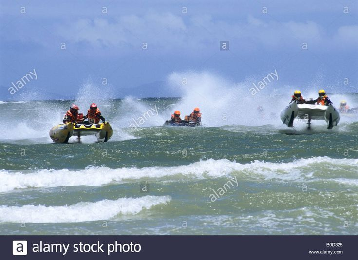 Rubber inflatable boats racing in annual Cape Agulhas race South Africa action sport movement transport competition destinations Stock Photo