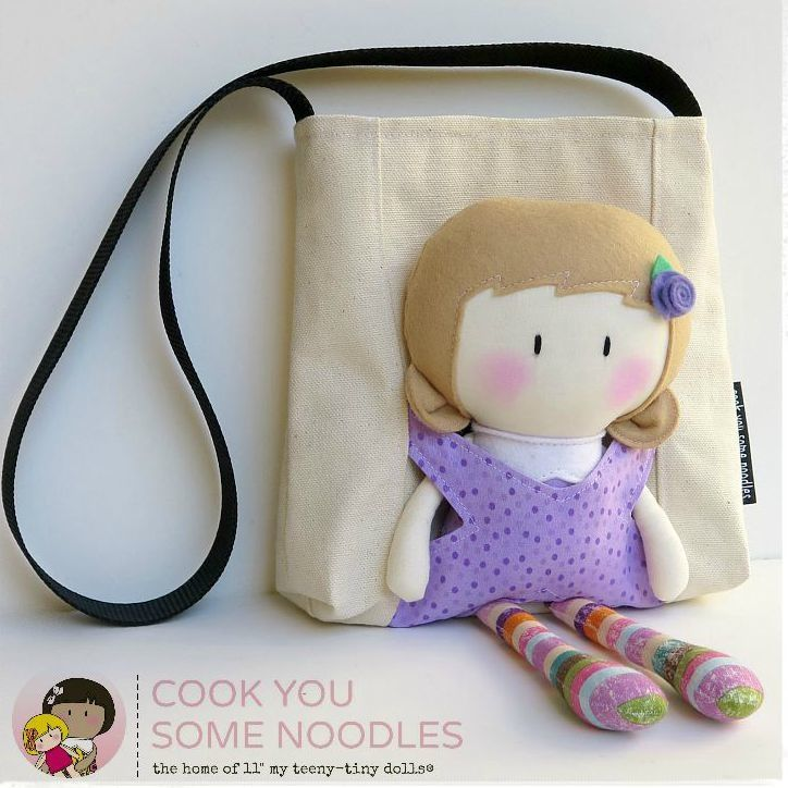 """Here's a great way for your little one to carry her 11"""" My Teeny-Tiny Doll® around - in a Carry-Me Bag.The bag measures 7"""" x 7"""" x 2"""" and has a long strap that come across the chest for extra security (don't want to leave the doll behind).Made from sturdy canvas, it can also fit in it a small book and any other toys, nic-nacs your little one would like to carry around.This listing is for 1 x MTTD Carry-Me Bag only. 11' My Teeny-Tiny Doll® not include..."""