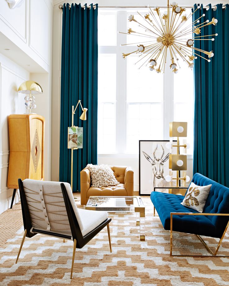 Mid-century mixed with a Jonathan Adler velvet sofa is a recipe for maximum glamour in any living room. Gorgeous teal drapes.