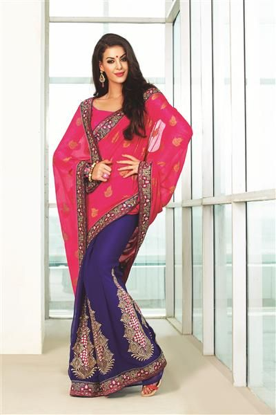 """A Beautiful Combination of cherry pink colour alongwith contrast blue colour all over the saree . the patli in the saree comprises of beautiful """"design"""" allover the saree which is comprised of zari work and blue thread work . the imitating diamonds add to the over look and feel of the saree. ** Contrast blouse Included ** *Blouse Included (unstiched)"""
