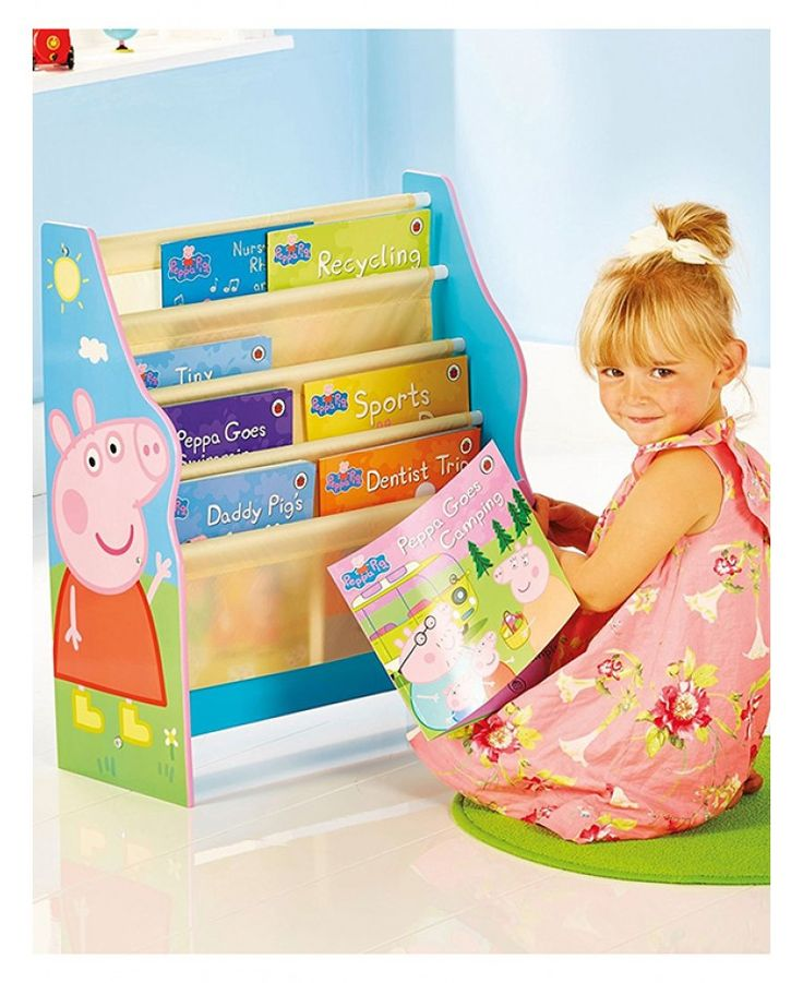 The Peppa Pig Sling Bookcase is perfect for keeping all little Peppa fan's rooms neat and tidy. The four fabric compartments can hold books of various shapes and sizes and is the ideal storage solution for bedroom and playrooms alike. The bookcase features colourful images of Peppa and George and has easy to assemble screw fixings which are supplied with all other components.