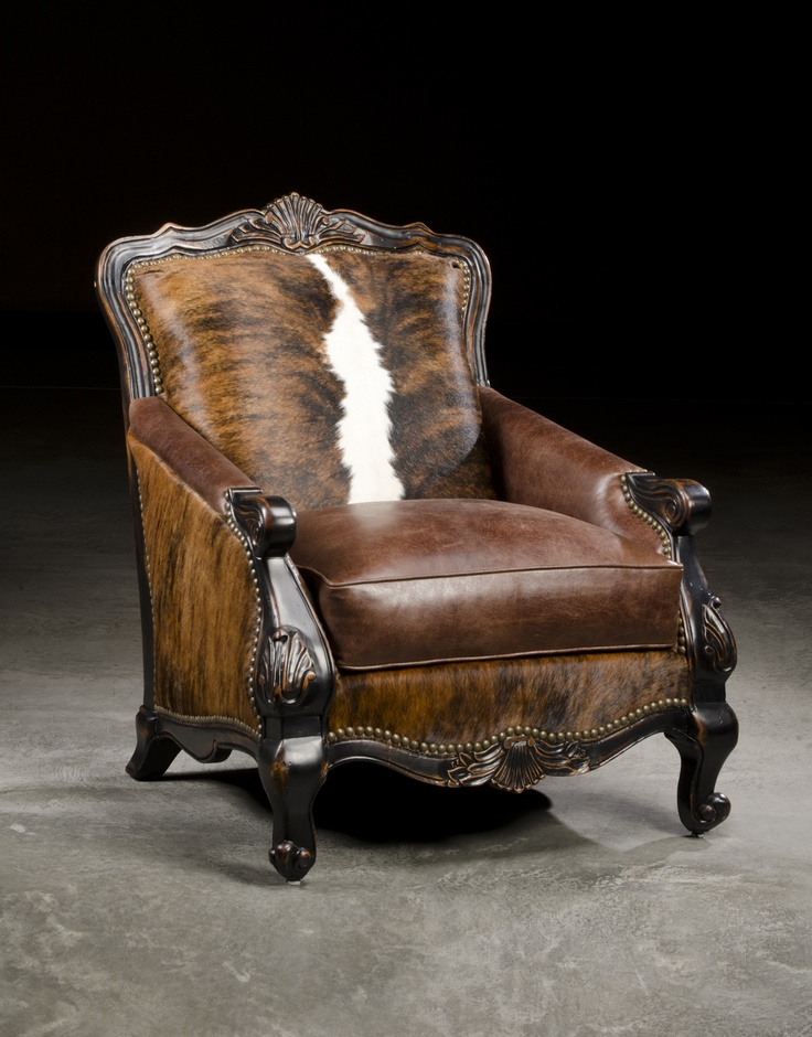 A stately leather cowhide library chair makes a great statement in any library room.  Or place two at your fireplace for that wow affect!