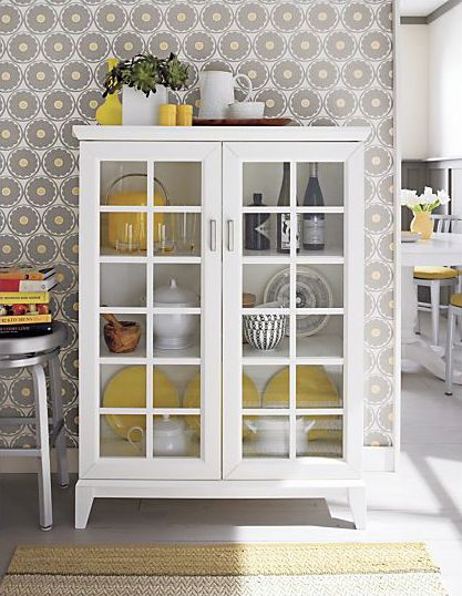 like this cabinet to display things in the kitchen - could free up some cabinet space for other things!