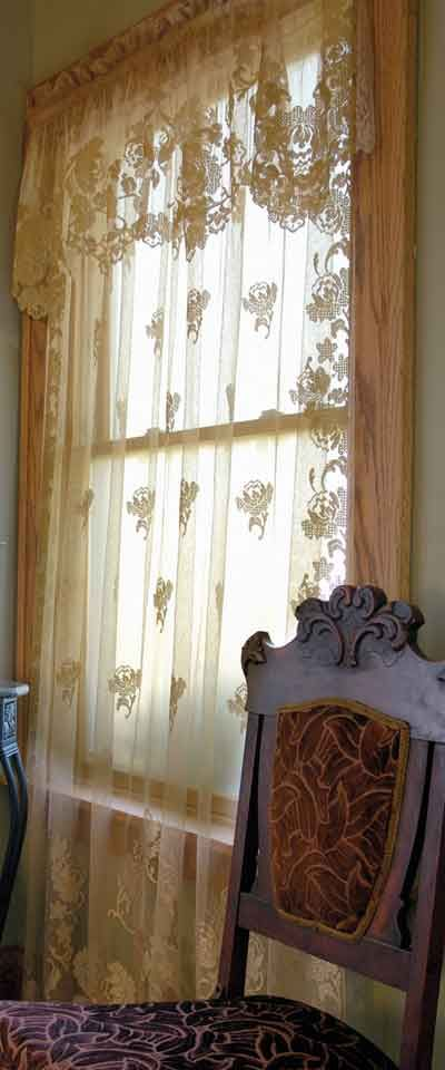 Windsor is a formal design available from Heritage Lace.  The Swag Pairs are $39.95 plus many other optional lace curtain pieces.