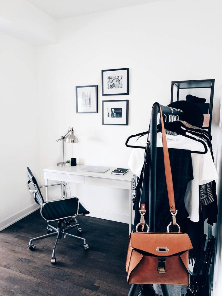 bright office with gallery wall clothing rack white desk - White Desk