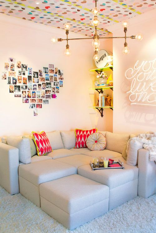 Love the wallpapered ceiling and the photo heart... I love the couch more than anything! It would be awesome in a movie room!