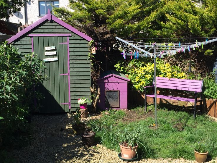 Garden sheds in bright colours.Ronseal purple berry used to brighten up garden furniture.